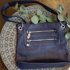 Royal blue shoulder purse w/silver metal details.